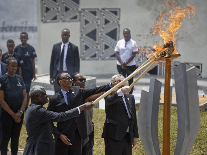 Rwandan first lady Jeannette Kagame and European Commission President Jean-Claude Juncker light the flame of remembrance at the Kigali Genocide