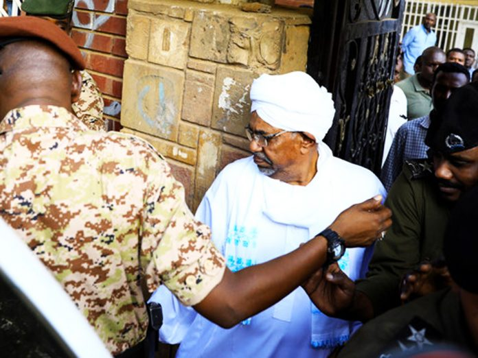 Sudan's ex-president Omar al-Bashir was charged with corruption-related offenses on Sunday as he appeared in public for the first time since he was overthrown in April.
